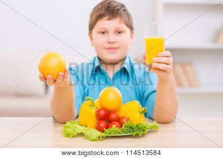 Chubby kid demonstrating healthy products.