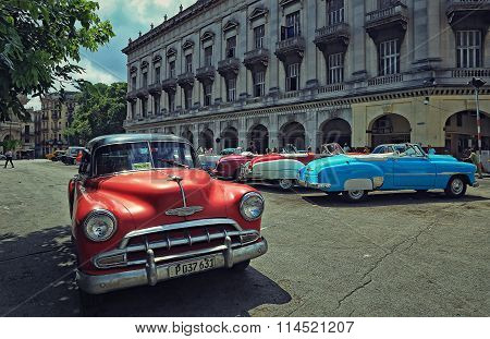 CUBA, HAVANA-JULY 10, 2015: Old American cars in the parking in front of the Capitol