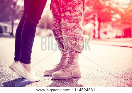 Young Military Couple Kissing Each Other, Homecoming Concept, Soft Focus, Cross Process  Toning Appl