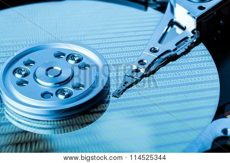 Close Up Of Hard Disk With Binary Language Reflection On Surface