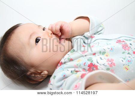 Japanese baby girl sucking her finger (0 year old)