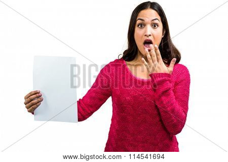 Portrait of tensed woman holding document on white background