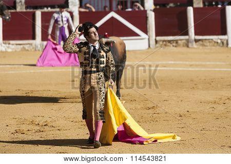 Spanish bullfighter Morante de la Puebla removing his montera to greet the public in Ubeda bullring