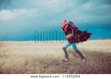 Nomadic woman holding blanket, enjoy freedom outdoor
