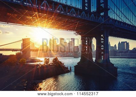 New York City - beautiful sunset over Manhattan bridge with Manhattan and Brooklyn bridge