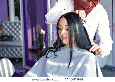 beauty saloon. Hairdresser makes styling