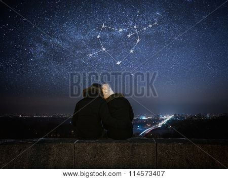 Valentines Day card. Couple in love looking at stars. Night in city. Constellation in shape of a heart