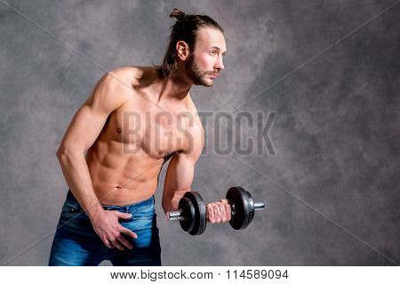 Young Man Exercised Body Train With Bar-bell