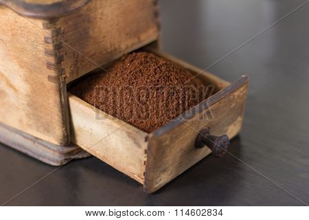 Close Up Of Open Drawer Of Coffee Grinder