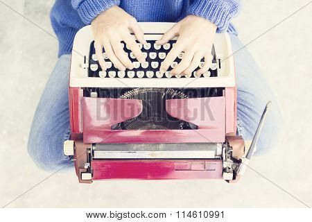 Top View Of A Woman Sitting On The Floor And Typing Typewriter