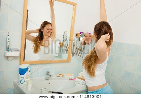 Woman Without Makeup Relaxing In Bathroom.