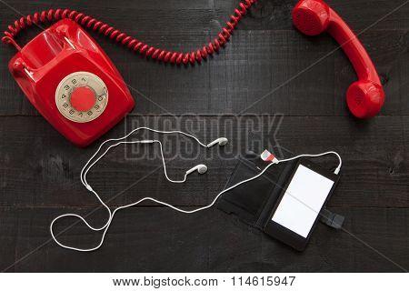 Vintage telephone vs smartphone