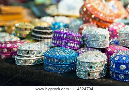 various of different colorful jewel boxes in Indian market