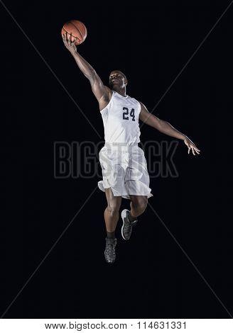 Basketball Player scoring a basket poster