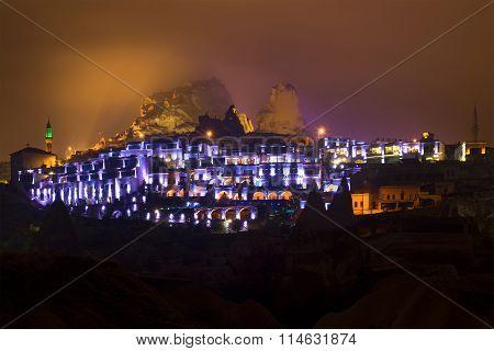 The old town of Uchisar in night illumination. Cappadocia