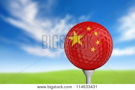 Golf ball with China flag colors sitting on a tee