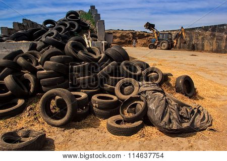 Heap Of Old Broken Used Tyres Near Country Road