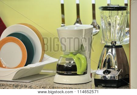 Kitchen With Coffee Maker And Fruit Press