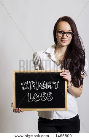 Weight Loss - Young Businesswoman Holding Chalkboard