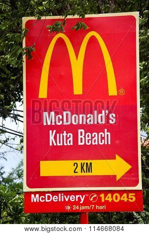 KUTA, BALI INDONESIA - DECEMBER 13 2014: McDonalds Street sign in Bali's tourist center
