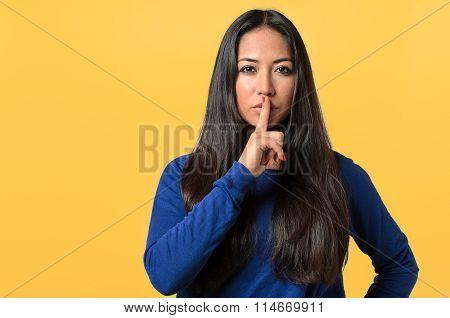 Pretty Woman Making A Shushing Gesture