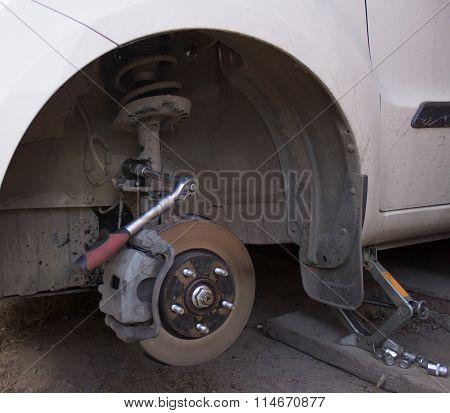 Car wheel on car repair station.