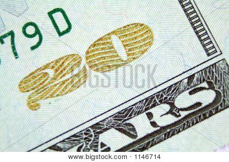 A Gold Glittery Twenty On A Twenty Dollar Bill