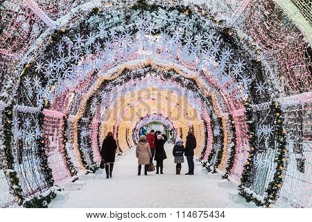 People And Tourists Walk Along Moscow Decorated For New Year And Christmas Holidays