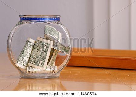 Swear Jar With Money On Table