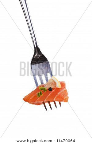 Salmon piece with lemon pepper corn and herb arranged on fork. poster
