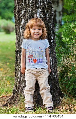 Cute Little Girl On Birch Tree