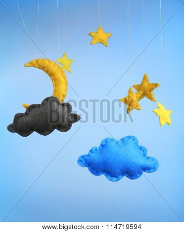 Fleece clouds with moon and stars on blue background