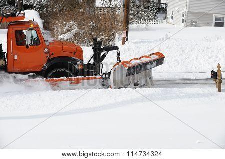 snowplow removing snow in winter
