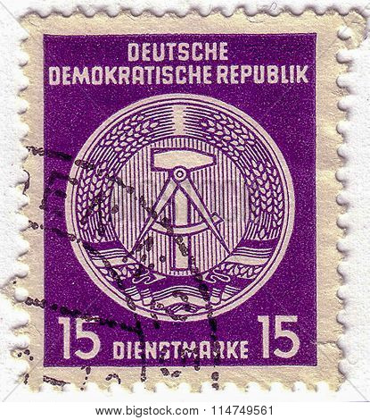 Gdr - Circa 1952: A Stamp Printed In Gdr Shows Gdrs National Coat Of Arms With Inscription