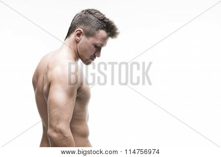 Handsome Muscular Bodybuilder Posing On White Background. Isolated Studio Shot With Copy Space