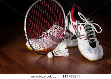 Shuttlecock, Badminton Racket And Shoe On Wooden Background
