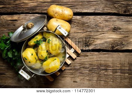 Boiled Potatoes With Herbs On Wooden Table . Free Space For Text.