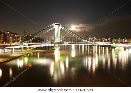 Bridge Flößerbrücke in Frankfurt with river Main