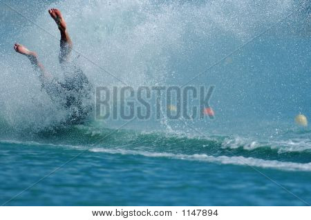 a barefoot waterskier crashes hard during competition. poster