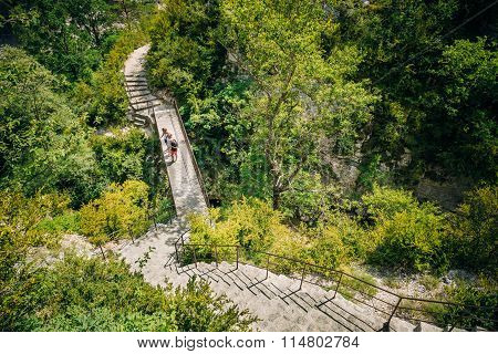Tourists descend the steps to the mountain river Le Verdon in th