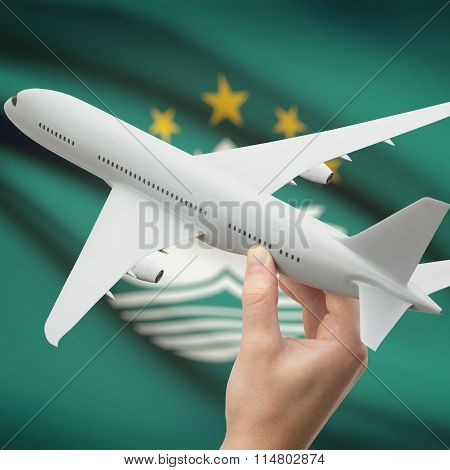 Airplane In Hand With Flag On Background - Macau