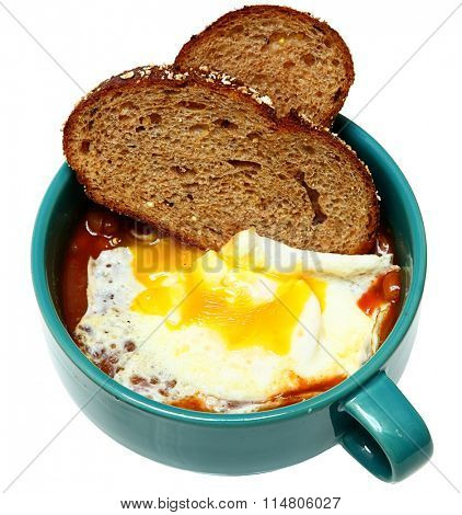 Southern Breakfast, Over Easy Fried Egg with Baked Beans and Toast in bowl over white.