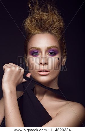Daring girl with a mohawk hairstyle, painted in gold, punk style. Beauty face.