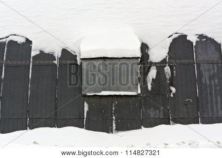Metal Hangar In Snow.