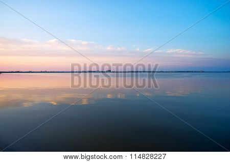 Clouds Reflected In The Waters Of Saki Salt Lake .