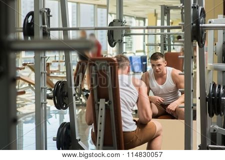 Young bodybuilder in gym.