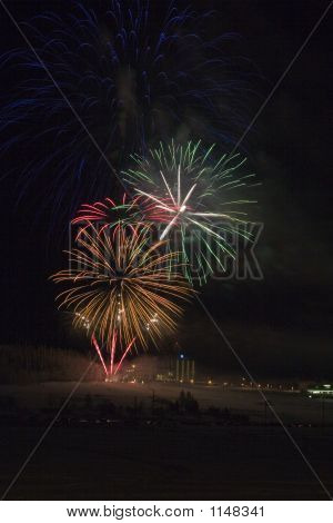 new years fireworks!!! multiple multicored explosions in the night sky poster