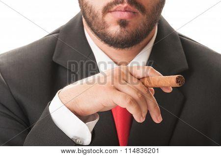 Young Business Man Smoking A Cuban Cigar.