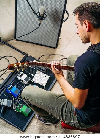 Guitarist Practicing In A Rehearsal Studio
