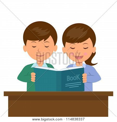 Boy and girl sitting at the desk reading a book.